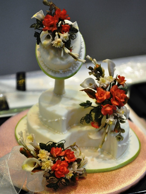 Miniature flowers on a tiny wedding cake